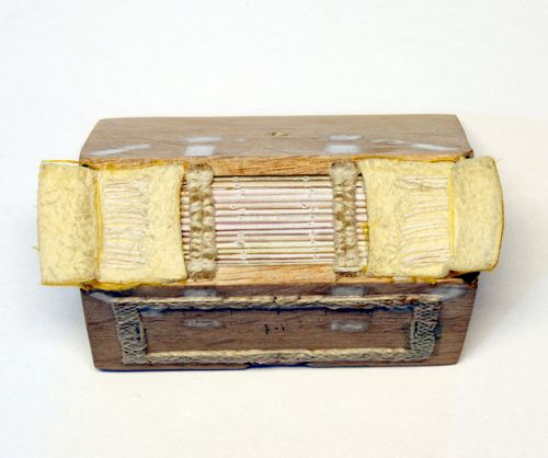 Spine of the spine linings at top and bottom layered with soft chamois and faced with yellow silk cloth. The hand sewn double endbands are structural, being laced through the boards and pegged before being wrapped in green and yellow silk thread.